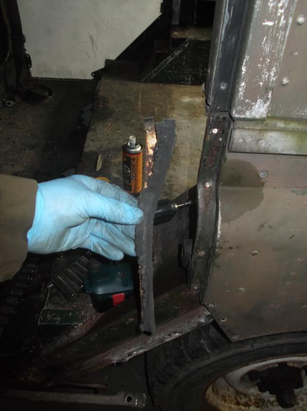 1965 series 2a station wagon drilling off rivets for door seals.JPG