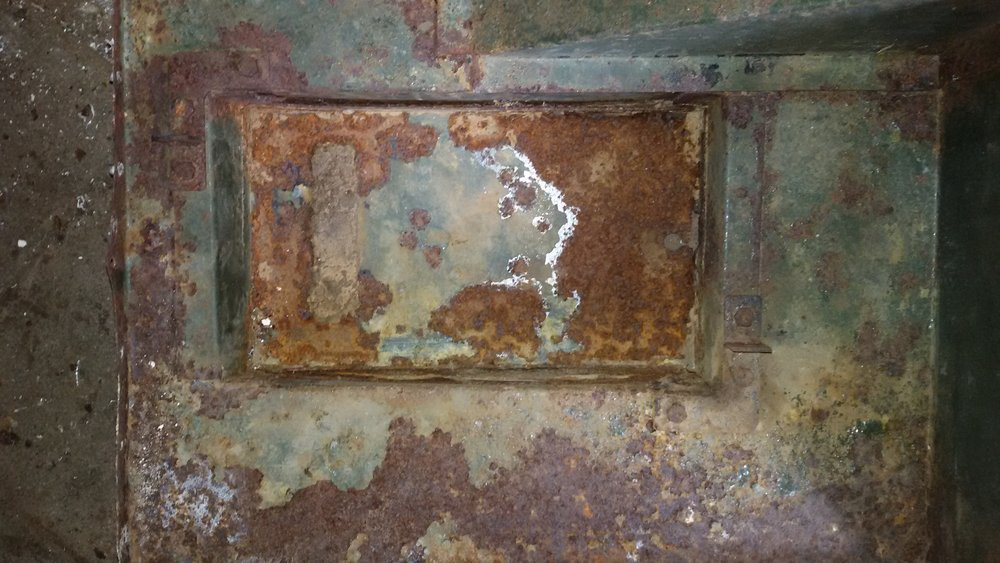 1965 series 2a station wagon rust in the bottom of the under seat battery tray.jpg