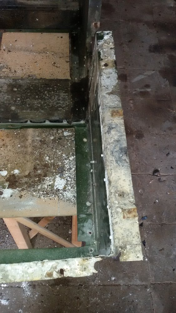 1965 series 2a station wagon seat tub corrosion near battery tray battery tray removed.jpg